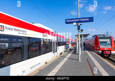 S-Bahn, Local train station, Dusseldorf-Hamm stop, the skyline of Düsseldorf city center, Medienhafen, Media port - Stock Photo