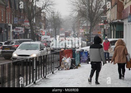 Traffic and people struggle in freezing weather, dubbed 'The Beast from the East' due to the sub zero cold temperature - Stock Photo