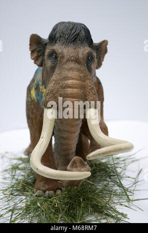Toy mammoth on white background - Stock Photo