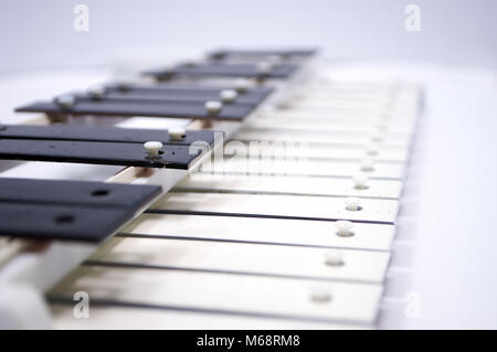 An old musical instrument on a white background - Stock Photo
