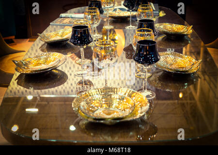 ... Table setting of luxurious glasses and plates in gold and black color - Stock Photo & Table setting of glamorous glasses and plates in gold and black ...