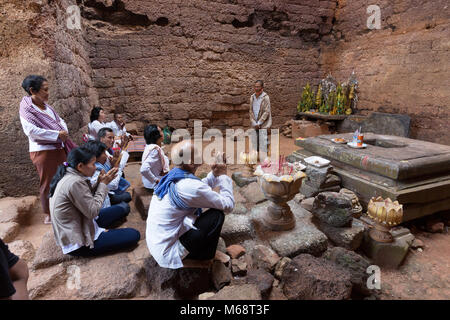 Buddhist religious ceremony in the interior of Phnom Da, an 11th century Hindu temple, Angkor Borei, Cambodia Asia - Stock Photo