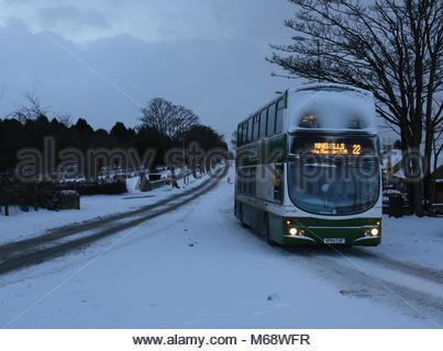 Number 22 bus on Glamis Road with snow Dundee Scotland  March 2018 - Stock Photo