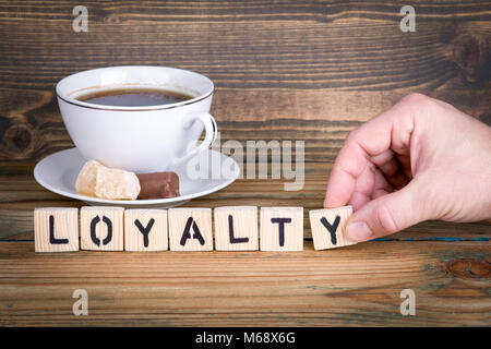 loyalty. Wooden letters on the office desk, informative and communication background - Stock Photo