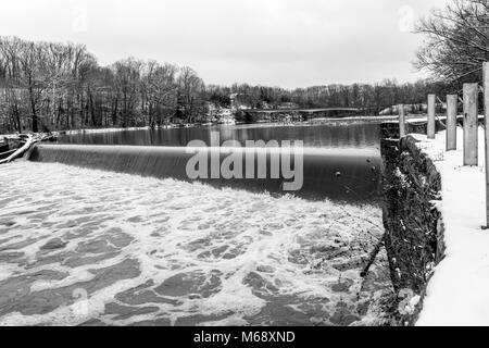 The Harpersfield Covered Bridge and Dam on the Grand River in Northeast Ohio. - Stock Photo