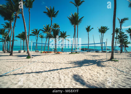 Volleyball net on tropical beach, caribbean sea. - Stock Photo