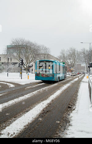 Southend On Sea, Essex, England, February 27th 2017, A bus picks its way through snow on Victoria Avenue. - Stock Photo