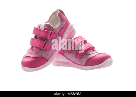 Baby girl small pink sport shoes isolated on white background - Stock Photo