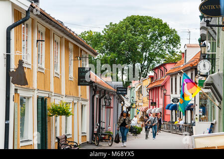 Traditional wooden houses on Stora Gatan street in heart of old town. Sigtuna, Sweden - Stock Photo