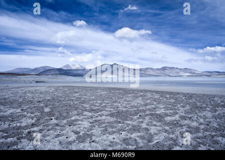 Salar de Aguas Calientes (Spanish for Hot Waters Salt Lake) and lagoon in the Altiplano (high Andean plateau) over - Stock Photo