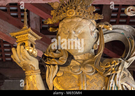 The huge statues in the Tōdai-ji a Buddhist temple complex located in the city of Nara, Japan. - Stock Photo
