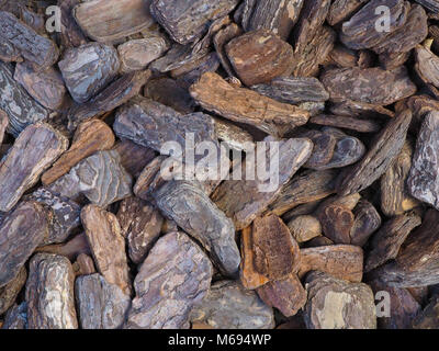 Large detailed bark pieces background photograph. Naturally textured and coloured bark pieces used in garden landscaping. - Stock Photo