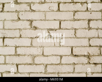 White country style brick wall background photograph. Rough textured bricks painted white in farmhouse style - Stock Photo