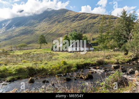 A former croft house in Glen Etive in the Scottish Highlands UK - Stock Photo