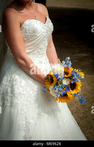 Wedding day bridal bouquet made up of sunflowers - Stock Photo