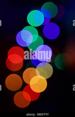 An out of focus view of coloured lights on a Christmas tree    Credit:  Ben Rector/Alamy Stock Photo - Stock Photo