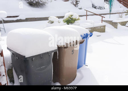 Largs, Scotland, UK - March 01, 2018: Three refuse bins in Scotland covered in snow about eight inches. happened - Stock Photo