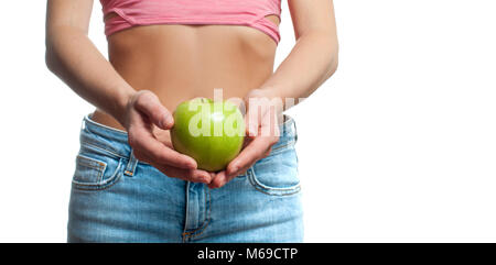 Diet concept. Beautiful perfect woman with slim waist is holding apple - Stock Photo