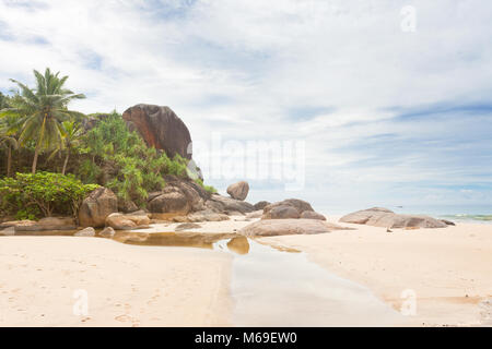 Bentota, Sri Lanka, Asia - A small river in front of huge granite rocks and palm trees - Stock Photo