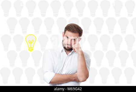 Business man having an bright idea light bulb concept. Handsome man thinking and dreaming - Stock Photo