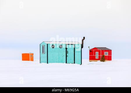 Ice fishing huts on Lake Winnipeg, Manitoba, Canada. - Stock Photo