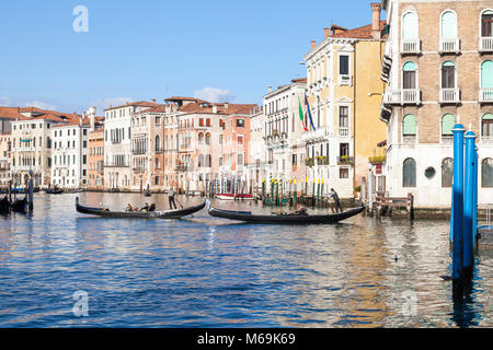 Two gondolas with tourists crossing the Grand Canal in Cannaregio, Venice, Veneto, Italy on a sunny winter day - Stock Photo
