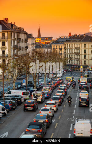 Boulevard Helvetique, traffic car scene at sunset. Old town, historic center. Genève Suisse. Geneva. Switzerland - Stock Photo