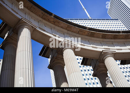 Close-up view of Millennium Monument with skyscrapers in background - Stock Photo