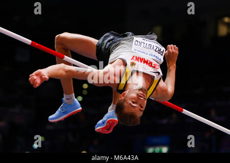 London, UK. 1st Mar, 2018. Germany's Mateusz Przybylko competes during the men's high jump final of the IAAF World - Stock Photo
