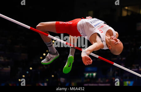 London, UK. 1st Mar, 2018. Sylwester Bednarek of Poland competes during the men's high jump final of the IAAF World - Stock Photo