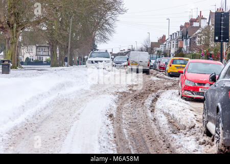 Northampton, England. 2nd Mar, 2018. UK Weather:. Slow moving commuter traffic on Park Ave South due to snow which - Stock Photo
