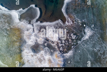 01 March 2018, Germany, Grossraeschen: The shallow shore areas of the Grossraeschen Lake are covered with ice (taken - Stock Photo