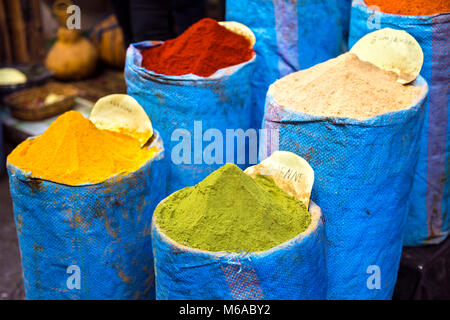 Colourful spices (Curcumin, Henna and Red Paprika) for sale in the souqs (market) in Fes, Morocco - Stock Photo