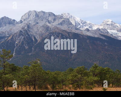 A Stunning view of Jade Dragon Snow Mountain in Lijiang Yunnan Province. Travel in China in 2012, November 18th. - Stock Photo