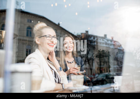 View through the window on the business people indoors - Stock Photo
