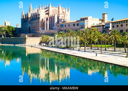 La Seu - the famous medieval gothic catholic cathedral. Palma de Mallorca, Spain. Water reflection. - Stock Photo