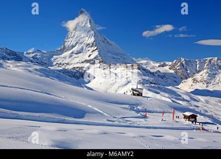 Chapel at Riffelberg 2582m in front of Matterhorn, 4478m, in winter, Zermatt, Mattertal, Valais, Switzerland - Stock Photo