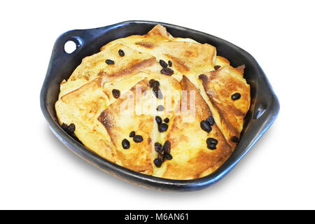 Studio shot of bread and butter pudding isolated on white - John Gollop - Stock Photo