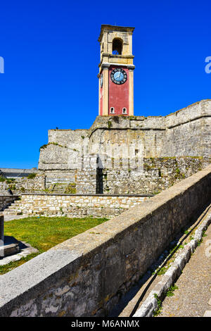The clock tower of the old fortress in Corfu Town on top of the old Kerkyra venetian fortress. - Stock Photo