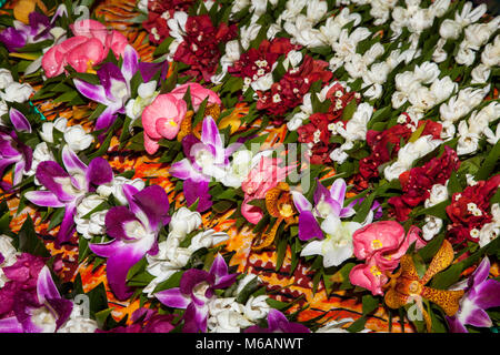 Flower chains, flowers, market hall in Papeete, Tahiti, French Polynesia - Stock Photo