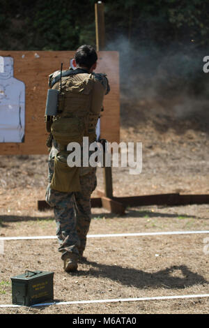 A Force Reconnaissance Marine with Maritime Raid Force, 31st Marine Expeditionary Unit, fires an M1911 .45 caliber - Stock Photo