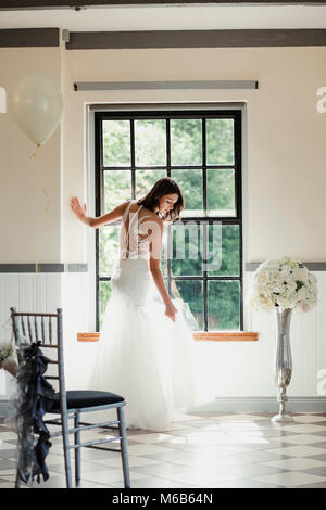 Young bride is having a moment to herself on her wedding day. - Stock Photo