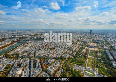 A view of Paris France from the Eiffel Tower in early autumn with the Seine, Champ du Mars, and Montparnasse Tower - Stock Photo