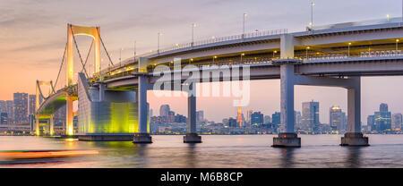 Tokyo, Japan skyline panorama with Rainbow Bridge and Tokyo Tower at dusk. - Stock Photo