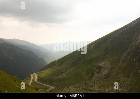 Part of the famous Transfagarasan Pass Road in the Transylvanian Region of Rumania on a rainy day. - Stock Photo