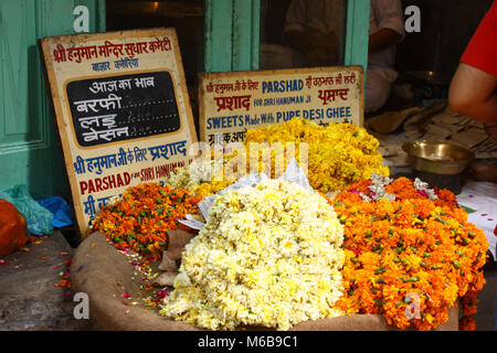 Bright yellow and orange flowers in a basket for sale for hinduist offerings in a market in Amritsar, India. - Stock Photo