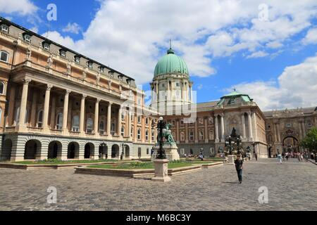 BUDAPEST, HUNGARY - JUNE 20, 2014: People visit Buda Castle in Budapest. It is the largest city in Hungary and 9th - Stock Photo