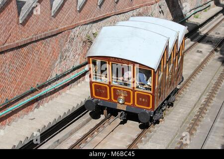 BUDAPEST, HUNGARY - JUNE 20, 2014: People ride famous funicular (cable car) in Budapest. It is the largest city - Stock Photo