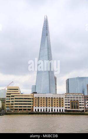 LONDON, UK - APRIL 22, 2016: Shard skyscraper in London, UK. The 309m tall building is the tallest in the European - Stock Photo
