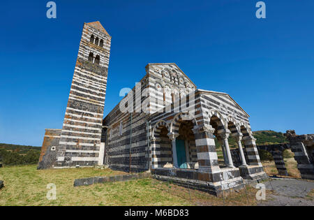 Picture and image of the exterior of the Tuscan Romanesque Pisan style basilica of Santissima Trinita di Saccargia, - Stock Photo